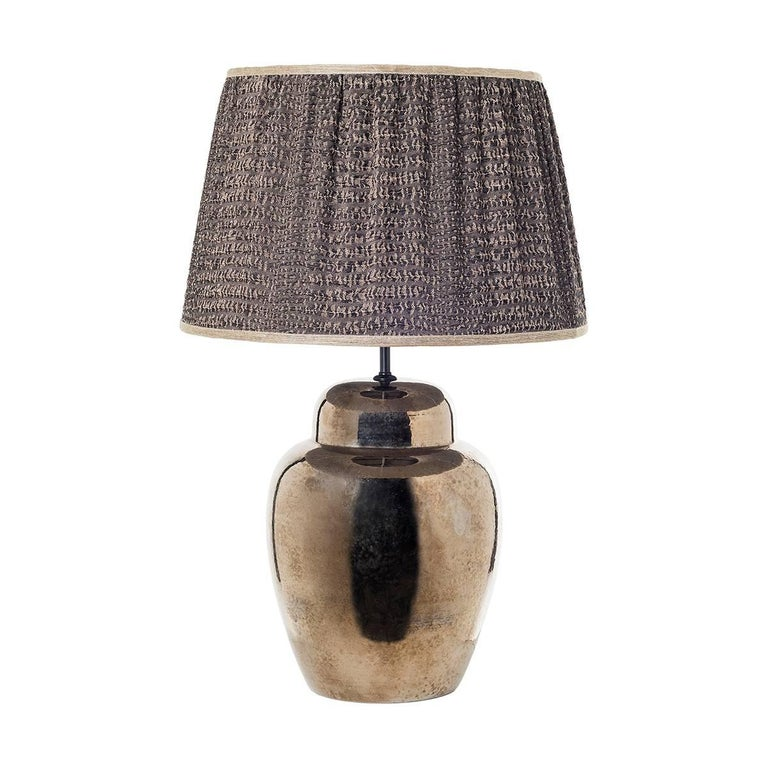 Pair of sinuous ceramic table lamps and shades. Sinuous ceramic table lamps decorated in platinum hand painted over a dripped glazed surface. The item is completed by a cylindrical fancy hand sewn shade. Wired to your request, 1 x E27/E26 screw bulb.