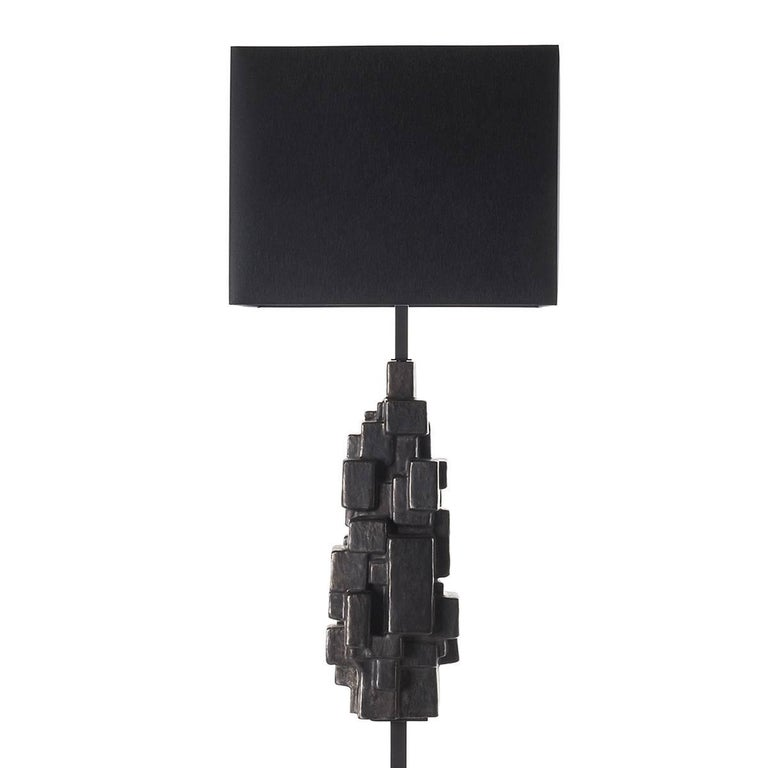 Sculptural ceramic floor lamp with shade. Superb way to glam up the space. This ceramic is skillfully glazed in a lead finish for a Brutalist mood. The floor lamp is complemented by a square black fabric shade. Wired to your request, 1 x E27/E26