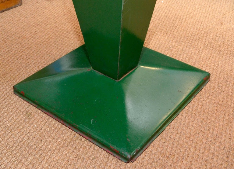 This rectangular Tolix green table is extremely rare. The squared base is in fact a typical feature that always characterizes the squared structure of the bistro table known as 'Cube' (commonly found in 80 x 80cm or 90 x 90cm, often with a hole at