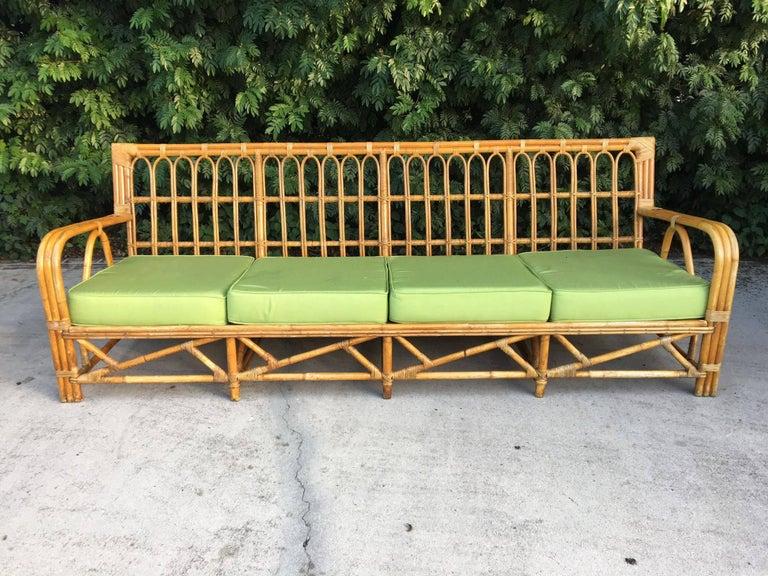Beautiful mid century rattan sofa measures over 96