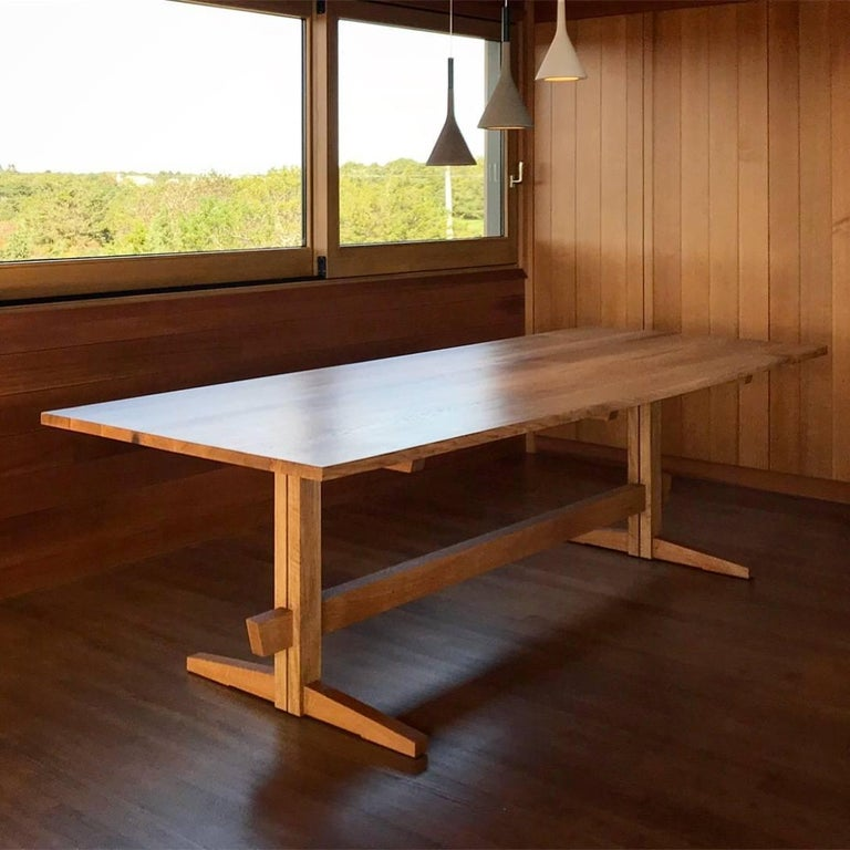 New York Heartwoods' contemporary Low-Trestle Dining Table is inspired by the timeless elegance of Asian and Mid-Century Modern design. Designed by Sojen Design exclusively for NYH, each table is handcrafted using traditional joinery techniques and