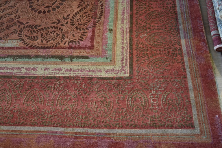 The quintessentially Indian paisley breaks through the borders that run in varying gradients across the carefully distressed rug.  As part of our proud to be Indian collection designed by Tarun Tahiliani, this piece celebrates Indian design and