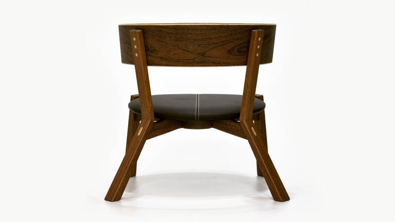 Armchair Toro is handcrafted in solid wood Freijó or Sucupira, including leather upholstery. The piece represents the Brazilian Contemporary design.