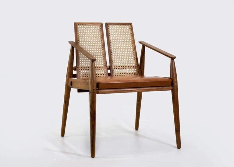 Chair Dalila is handcrafted in solid wood Freijó, including leather upholstery. The piece represents the Brazilian Contemporary design.
