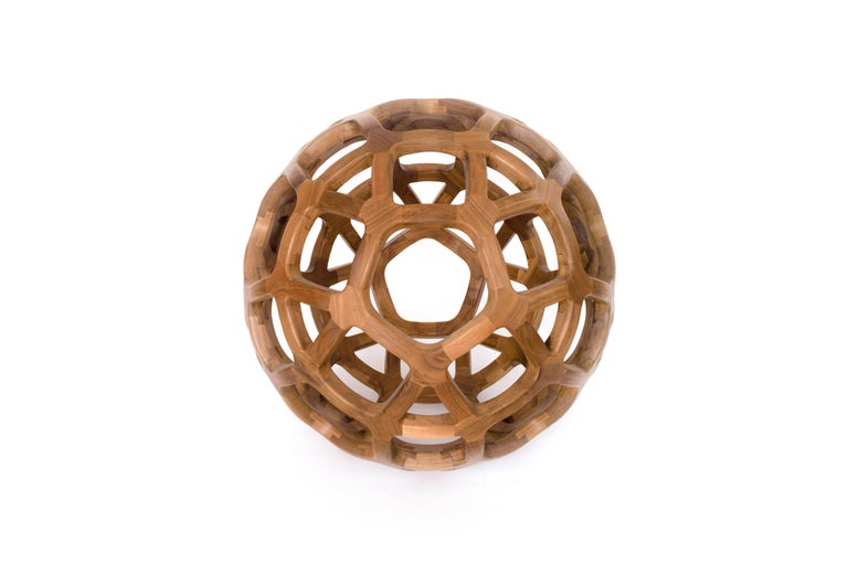 This is a limited edition solid walnut sculpture created by renowned Mexican designer Pedro Cerisola, whose work is in the permanent collection of the National Autonomous University Science Museum and has been exhibited in the Franz Mayer Design
