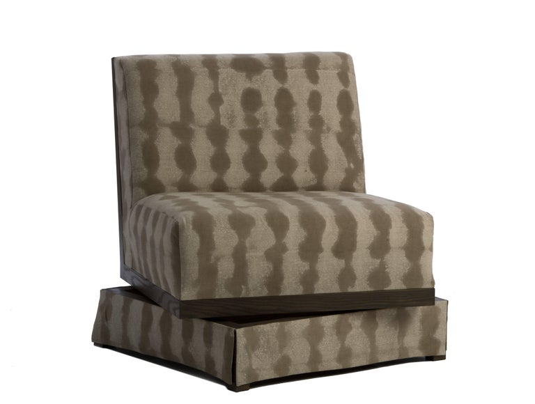 Designed by Ashley Yeates, handmade in the United States, a maximized seat space with open comfort, the armless swivel highlights North American ashwood details on the seat back and is the perfect complement to traditional and contemporary spaces