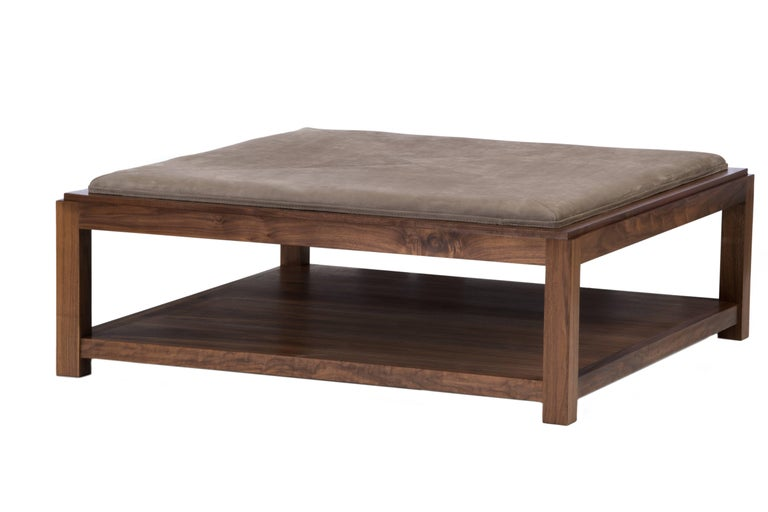 Designed by Ashley Yeates, the Landon coffee table is hand made in the United States, offers versatility and defines this multipurpose piece as the North American Walnut top reverses to a suede cushion ottoman. The ideal piece for indecisive minds