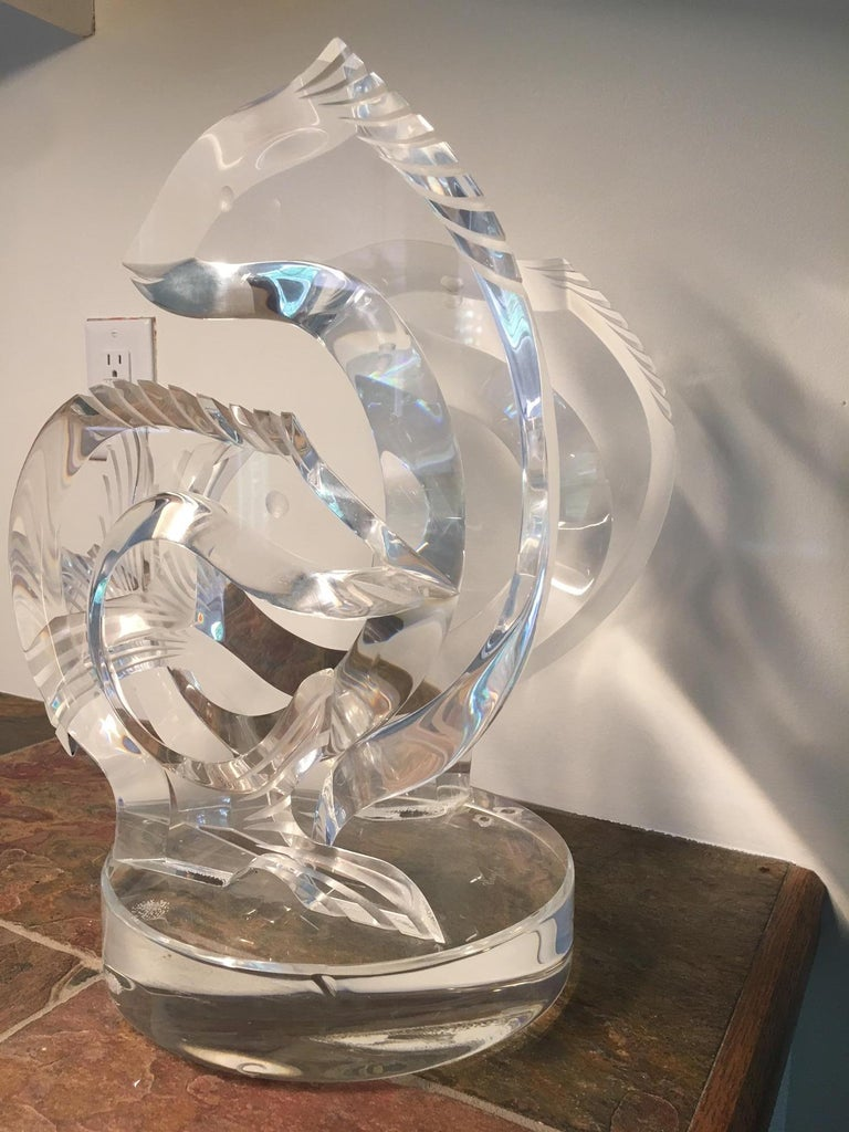 This detailed and polished Lucite piece is a treasure. It is signed in etching