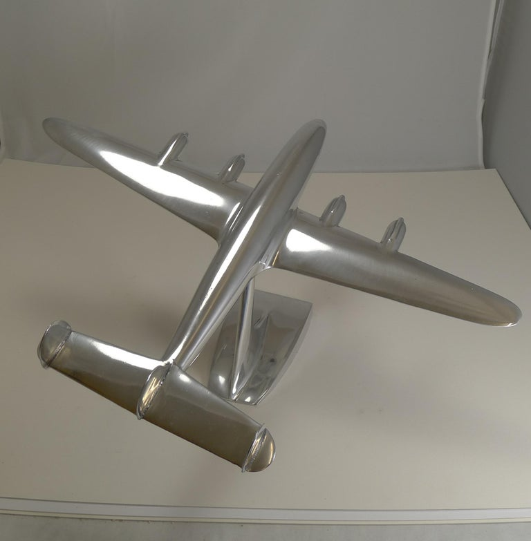A handsome and highly collectable polished aluminium aircraft model on a stand.  The Lockheed Constellation (