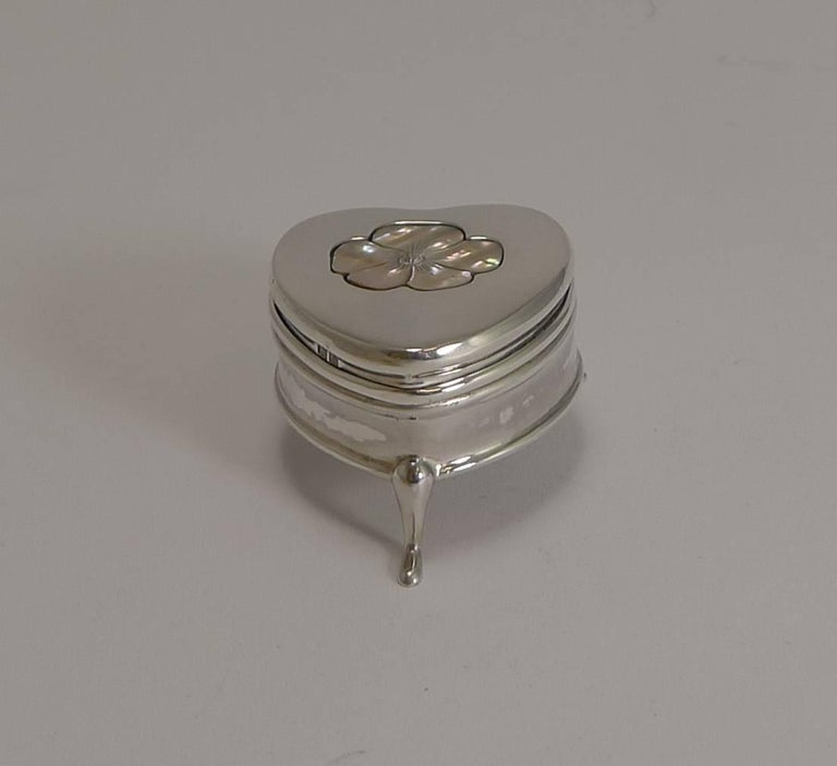 Made from English sterling silver, it stands on three pretty legs and is fully hallmarked for Birmingham 1909, Edwardian in era; the makers initials are also present for the well renowned silversmith, Cornelius Desormeaux Saunders & James Francis