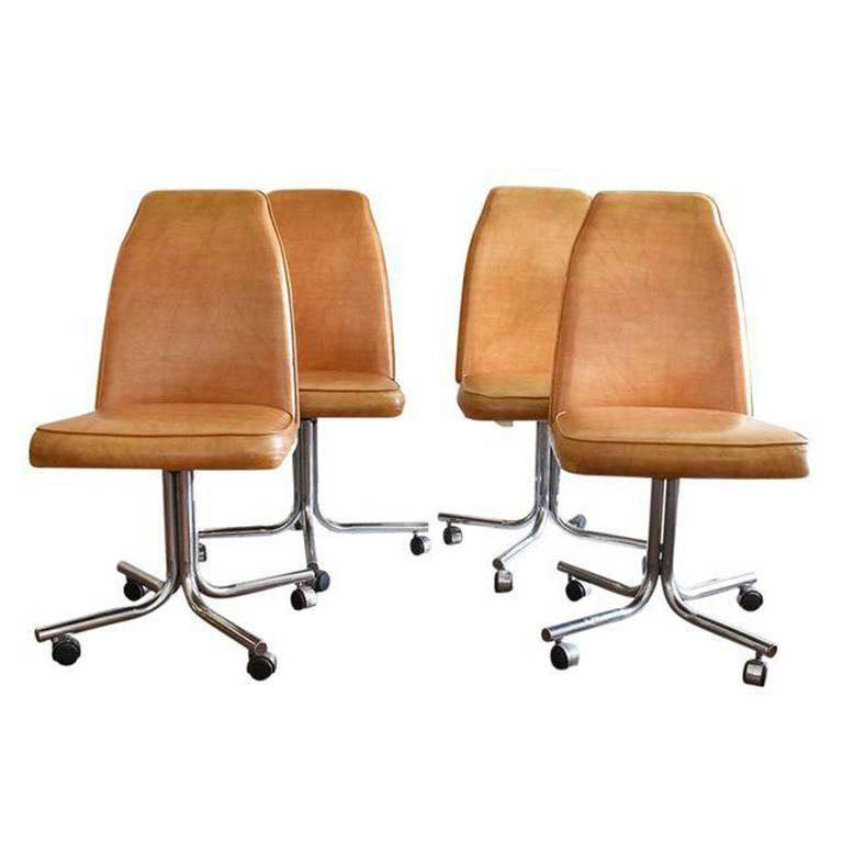 Midcentury and Chrome Rolling Brown Bucket Chairs, Set of Four