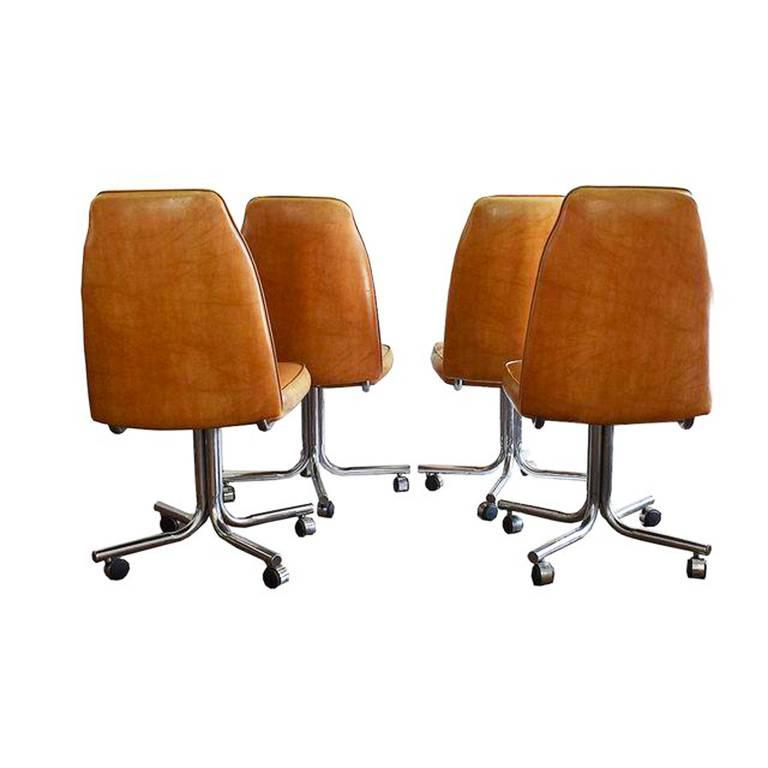 Mid-Century Modern Midcentury and Chrome Rolling Brown Bucket Chairs,Set of Four For Sale