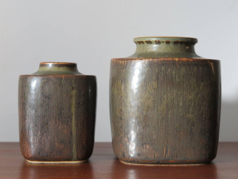 Set of two vintage Scandinavian stoneware amazing big vases designed by the Danish artist Valdemar Petersen for Bing & Grondahl from the 1960s in Copenhagen with matt glazed and with signature engraved on the bottom.