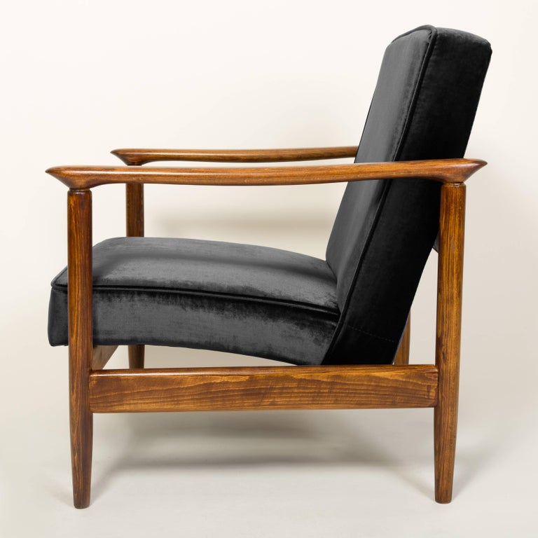 Beautiful armchair model GFM-142, designed by Edmund Homa. The armchair was made in the 1960s in the Gosciecinska Furniture Factory. Frame is made from solid beech wood. The GFM-142 armchair is regarded one of the best Polish armchair design from