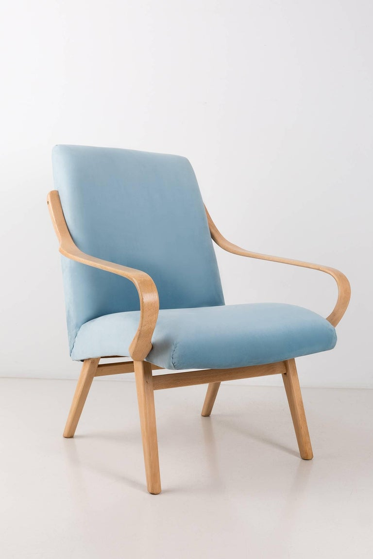Armchairs designed by Jaroslav Šmidek, type 53. They were manufactured at the Ton factory in the 1960s in Czech Republic. Purified beech wood polished and finished with matt varnish. The upholstery that is covered with the seat and backrest is a