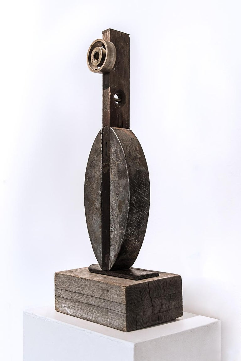 Bird I wood, steel, carpenter's level, bronze 12 x 8 x 31 in  Artist statement:  I seldom use stock material, but prefer distressed and rusted steel that has been scarred, bent, and made imperfect. In this state, the material becomes quite