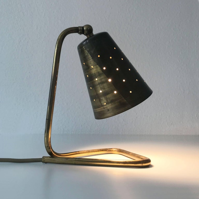 Stunning Mid-Century Modern Scandinavian table lamp with perforated diffuser. Probably designed by Hans Bergström, Sweden, 1950s. Executed in brass tube and sheet, it gives a wonderful light effect due to perforated and adjustable diffuser. It