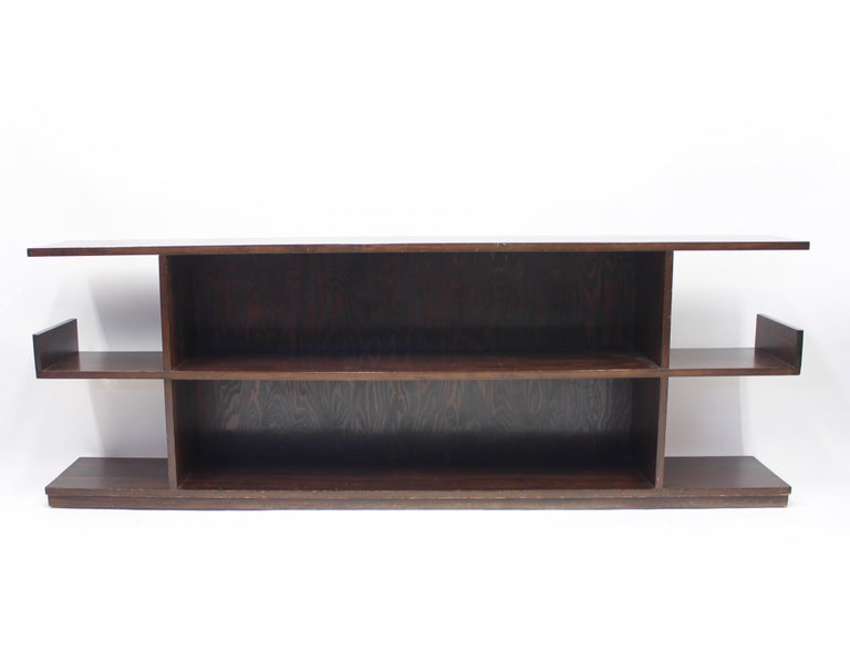 Low Swedish bookshelf/sideboard in stained birch and stained pine attributed to Axel Einar Hjorth, made in the 1930s. Very good vintage condition with light ware.