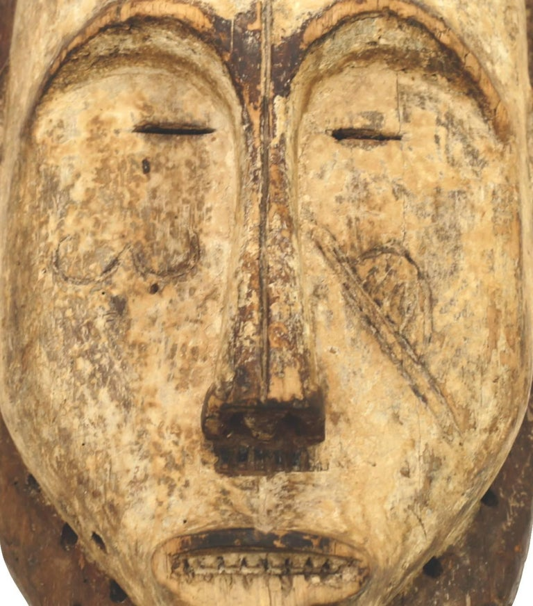 Beautifully carved wood ritual mask from Gabon, Libreville, circa 1950s.