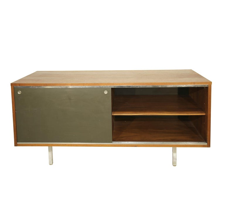 Handsome George Nelson credenza designed in 1952 for Herman Miller. Walnut, stainless steel and black laminate.