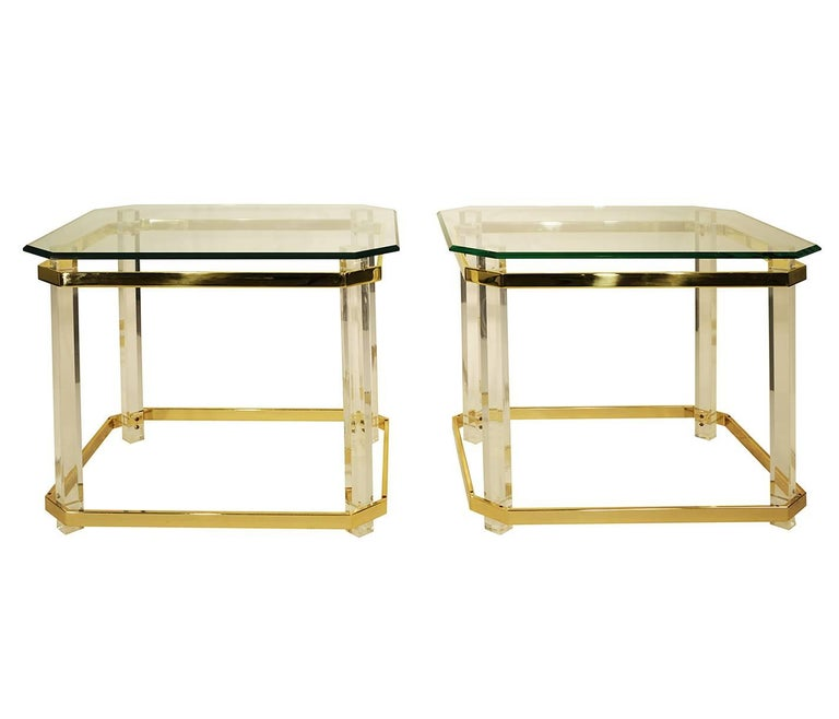 Pair of Charles Hollis Jones Lucite and brass, glass side tables. The tops have