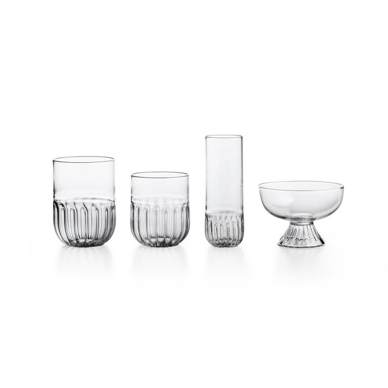 """Mouth blown water glass. The routine collection is a glassware family designed by Matteo Cibic, who define it as """"an essential collection for a smart daily life"""". All the pieces of Routine are handcrafted and feature a soft plissé motif at the base"""