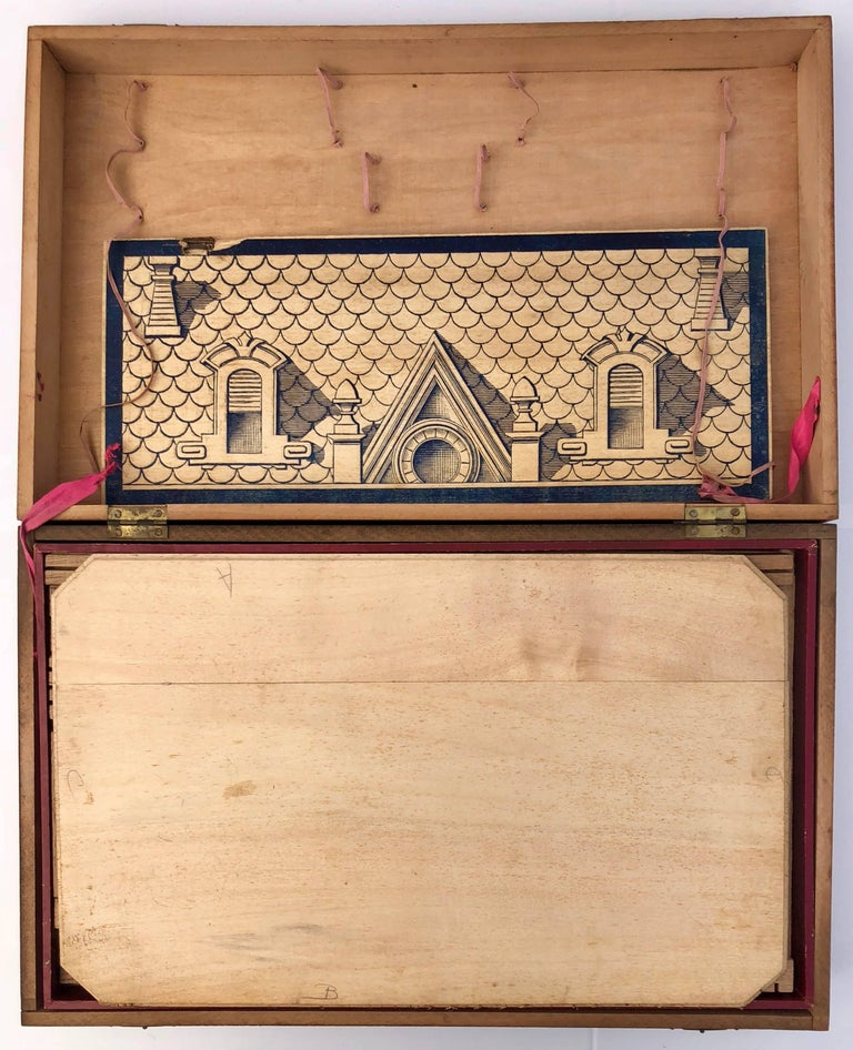 This is a French early 1900s wooden construction game wooden game with 3 drawers,