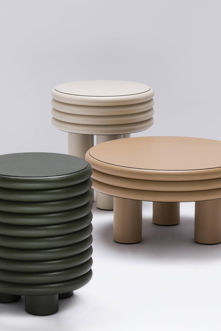 """The """"stacked"""" shape often seen at the base of some buildings in Italy, as well as Salvatore Ferragamo's celebrated heel inspired this line of nappa-covered furniture. An identical recurring motif, layered and highlighted by deliberately thick legs,"""