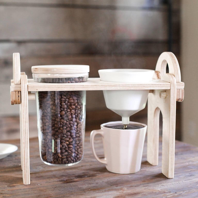 Savant Pour over set -The Savant Pour over coffee set up. Including a handled stand that breaks down for mobility, a handblown glass jar by Hayden Wilson, and a porcelain pour over that fits an average coffee filter. There is the perfect amount of