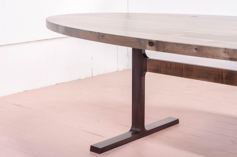 The shaker table is the first award winning design from the studio at Jeff Martin Joinery. It examines the interface between cast bronze and solid wood using bronze casting for joinery functionality. 