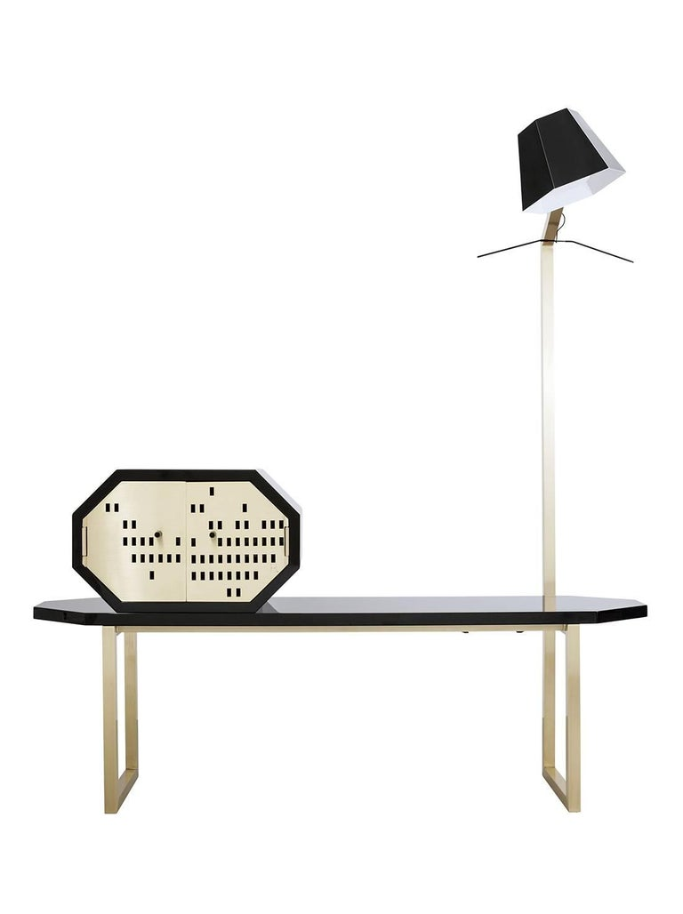 Creating a union of various pieces of furniture in a harmonic way. Mappamondo combines the function of a bench, containers for quick storage, of which one is removable and a standing lamp which is also a coat hanger.