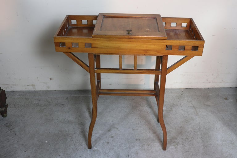 Beautiful important Italian Art Nouveau sewing table in cherrywood. these small tables were used by seamstresses who used the internal compartment to store their weaving tools. The antique table used condition need of restoration as you can see