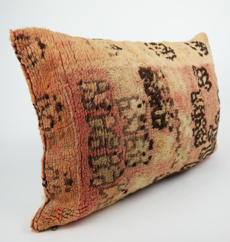 Cushion custom-made from a more than 40 years old Moroccan rug. The rug is searched and selected by ourselves. This pillow is a one-of-a-kind with beautiful warm colors. shades of warm orange, faded pink, chocolate brown, sand and vintage