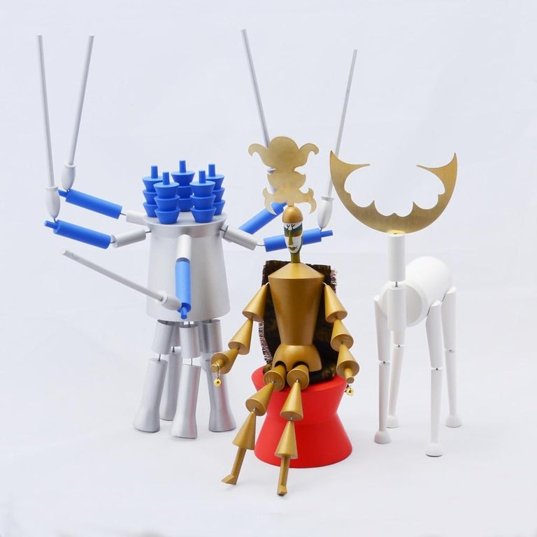 """These posable figurines are based on the original 1918 Dada marionettes by Sophie Taeuber-Arp. The original marionettes (17 in all) were created by Taeuber-Arp for a richly embellished Dada version of """"King Stag"""", a tragicomedy by Carlo Gozzi."""