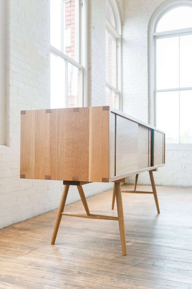 Turned Pelican Cabinet, Display Piece Modern White Oak Sideboard with Sliding Doors For Sale