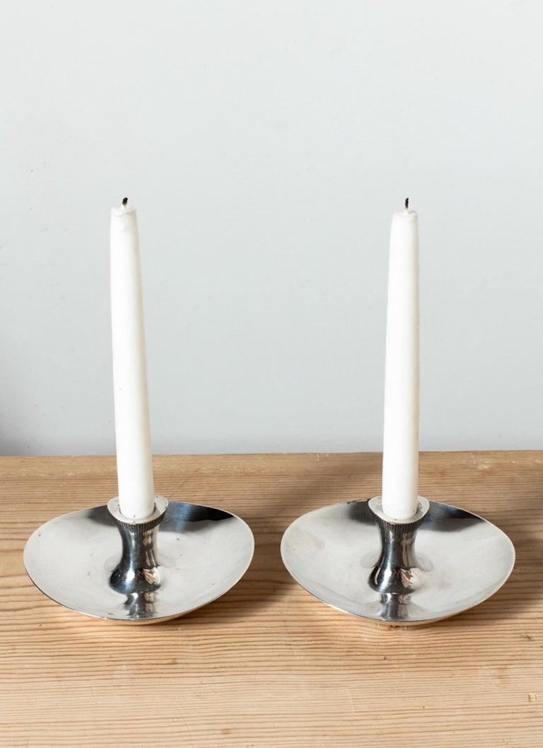 Pair of silver candlesticks by Tapio Wirkkala (1915 Finland 1985) Manufactured by Helsingfors Stamped: Käyttökulumaa, steariinin 'jälkiä, 1966.