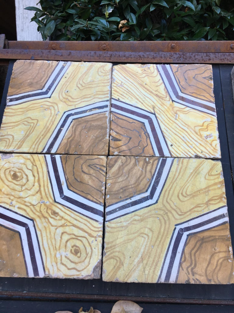 Italian vintage reclaimed decorated tiles from early 20th century. 79 pieces available, approximately 3,16 sqm
