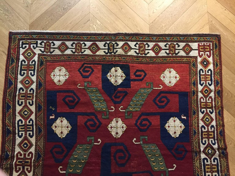 19th Century Kazak Pinwheel Crab Caucasian Rug Hand-Knotted Red Blue Green White In Excellent Condition For Sale In Firenze, IT