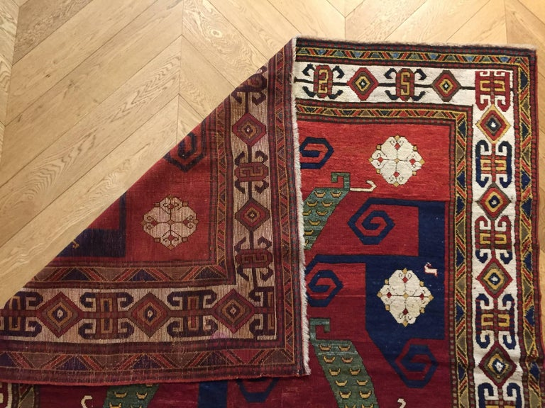 Wool 19th Century Kazak Pinwheel Crab Caucasian Rug Hand-Knotted Red Blue Green White For Sale