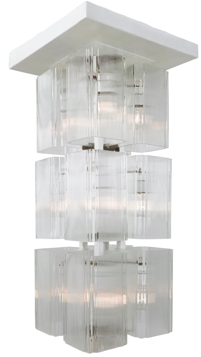 Large set of 30 x flush-mounts -chandeliers in white painted metal and art glass, Europe, 1970s. The diffuse light it spreads is very atmospheric. Completed with the 12 art-glass and white painted metal frame, these lights will contribute to a