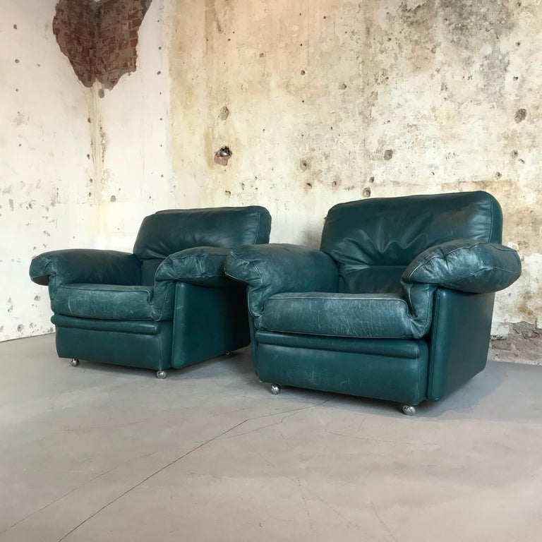 Pair of large impressive vintage lounge chairs by Poltrona Frau, 1970s, the very best quality from Italy. Comfortable overstuffed proportions in amazing luxurious petrol (bluish green) nappa leather makes these easy chairs the perfect set for home