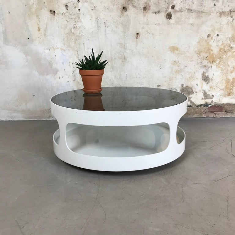 If you are looking for a stylish designer's coffee table with a space age look for your mid-century interior then this cool table could be perfect for you. It is designed by Erik van Buijtenen and produced by Nebu Holland, 1970s.  The white base