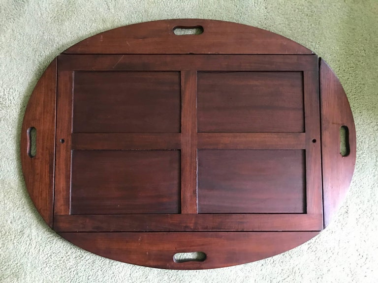 "George III mahogany Butler's tray circa 1780, with brass bound hinges. Stand is not original and much newer. Measures: 31.5"" W 39.5"" L 25"" H Handles up: 22"" W x 31"" L."