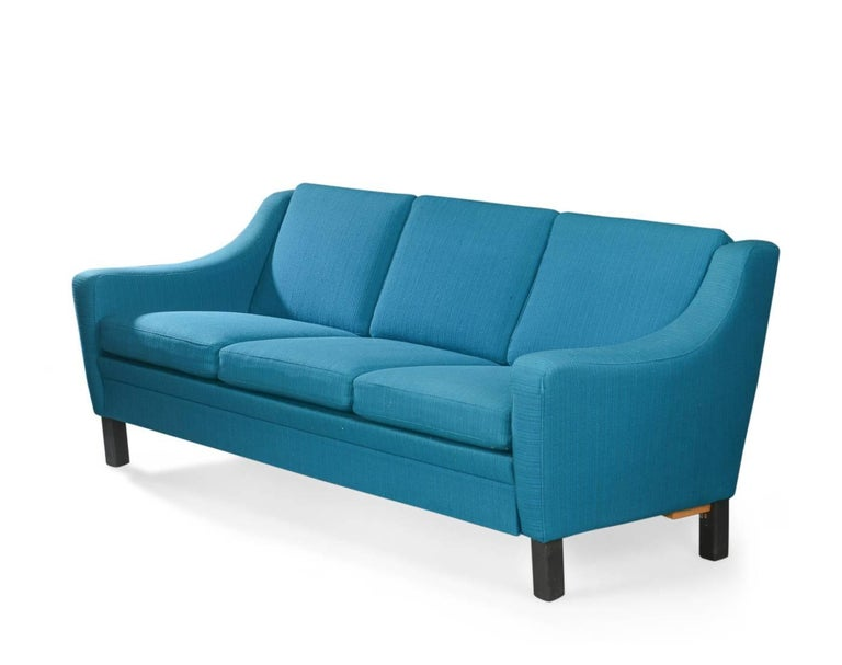 Upholstered Sofas In Turquoise Wool Soft Cushions And Legs Black Lacquered Wood