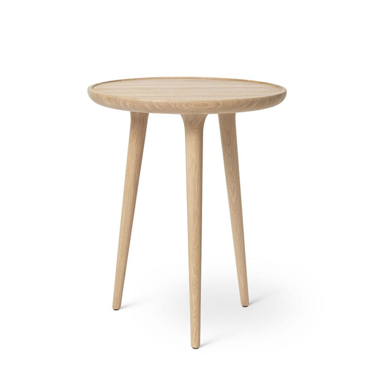 The Mater accent table is designed by the Danish architect duo Space Copenhagen and combines a sculptural and handcrafted aesthetic. Following along the same bloodline as the highly successful 2009 Mater High Stool, the Accent collection consists of