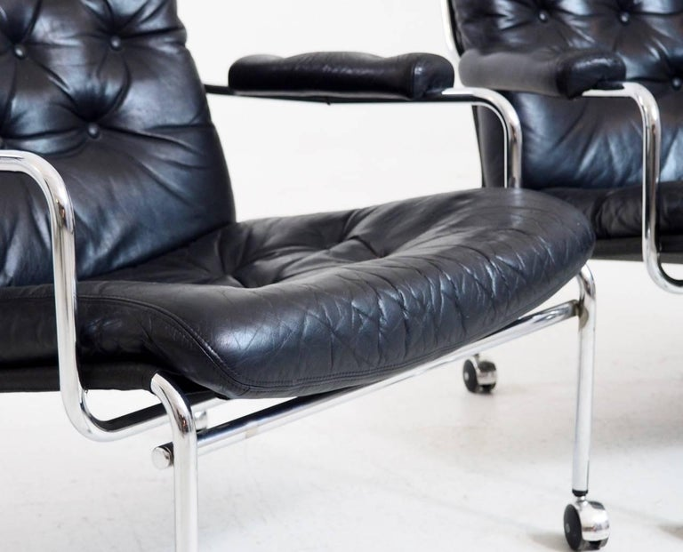 Fine pair of 1960s leather armchairs in steel, probably by Bruno Mathsson (1907-1988).