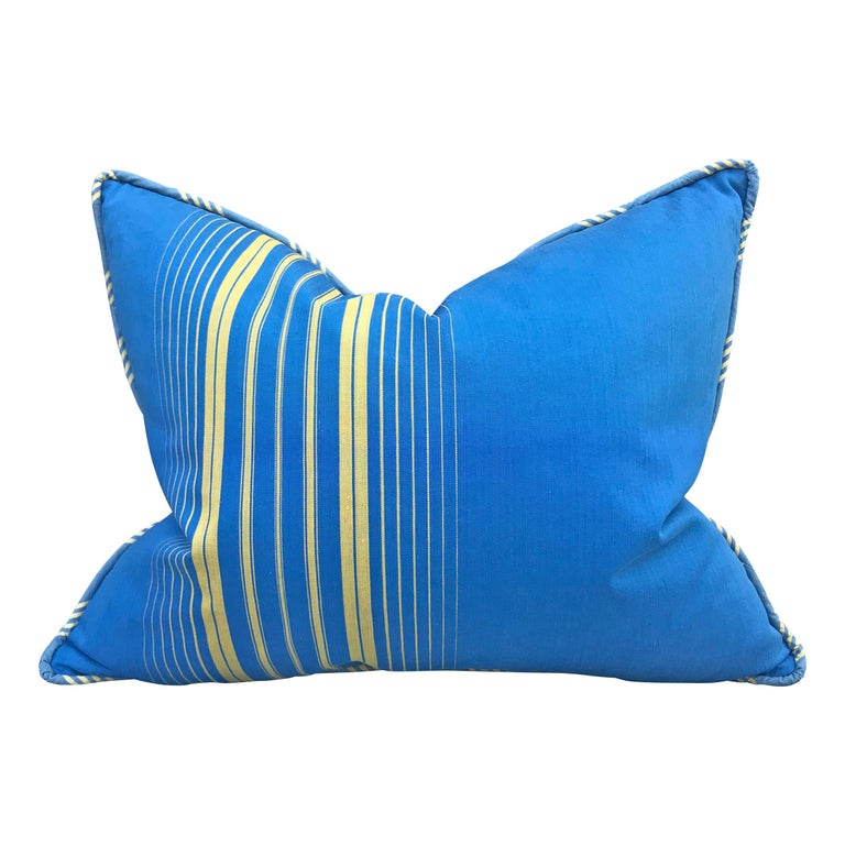A pair of early 20th century French blue and yellow striped cotton pillows woven with a petite twill pattern. Backed with the same fabric, self welt, and filled with down.