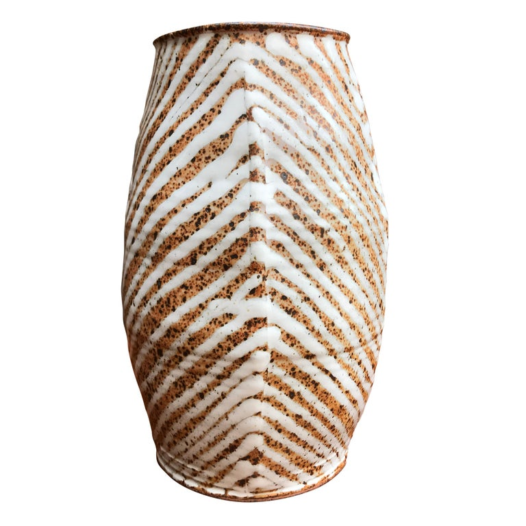 A wonderful mid-20th century wheel-thrown studio pottery vase with vertical ridges at each