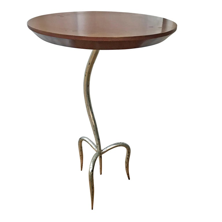 A late 20th century artist-made table with a hand-forged iron base with three legs and a silver-leaf finish. The top is maple.