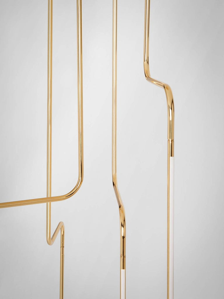 SEM Gold collection , four arms composition ceiling lamp in polished or fine brushed tubular brass with double joint. Different sizes and compositions : H 110/155/175 cm. Horizontal arm length measurement 20 cm. Lamp type LED 6W - 3000°K Voltage